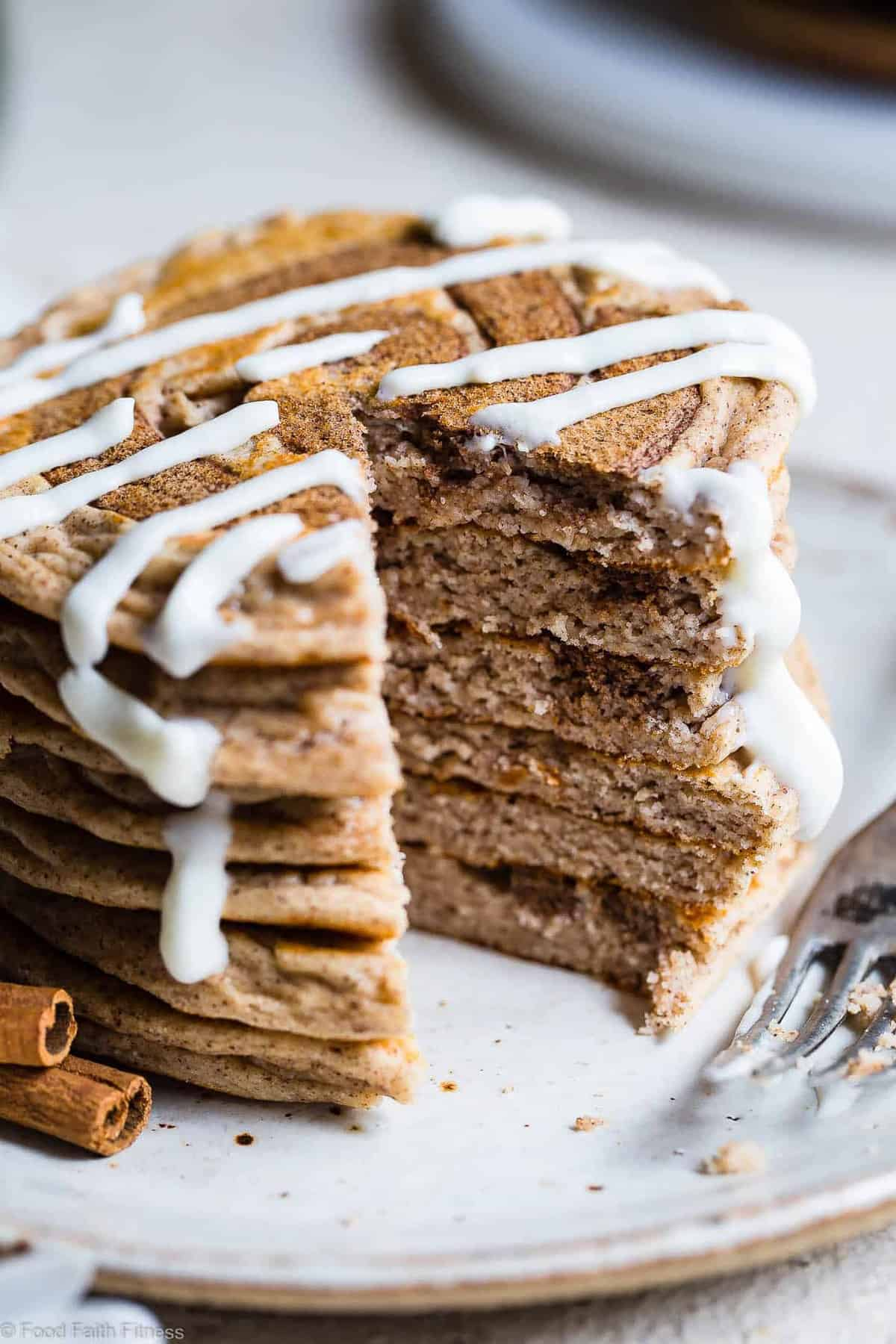 Cinnamon Roll Keto Protein Pancakes -This EASY, low carb, gluten free protein pancakes recipe is going to be your new favorite breakfast! Great for kids and adults and packed with 23g of protein!Who doesn't want to wake up to healthy cinnamon rolls?! | #Foodfaithfitness | #Keto #Lowcarb #Glutenfree #Healthy #Pancakes