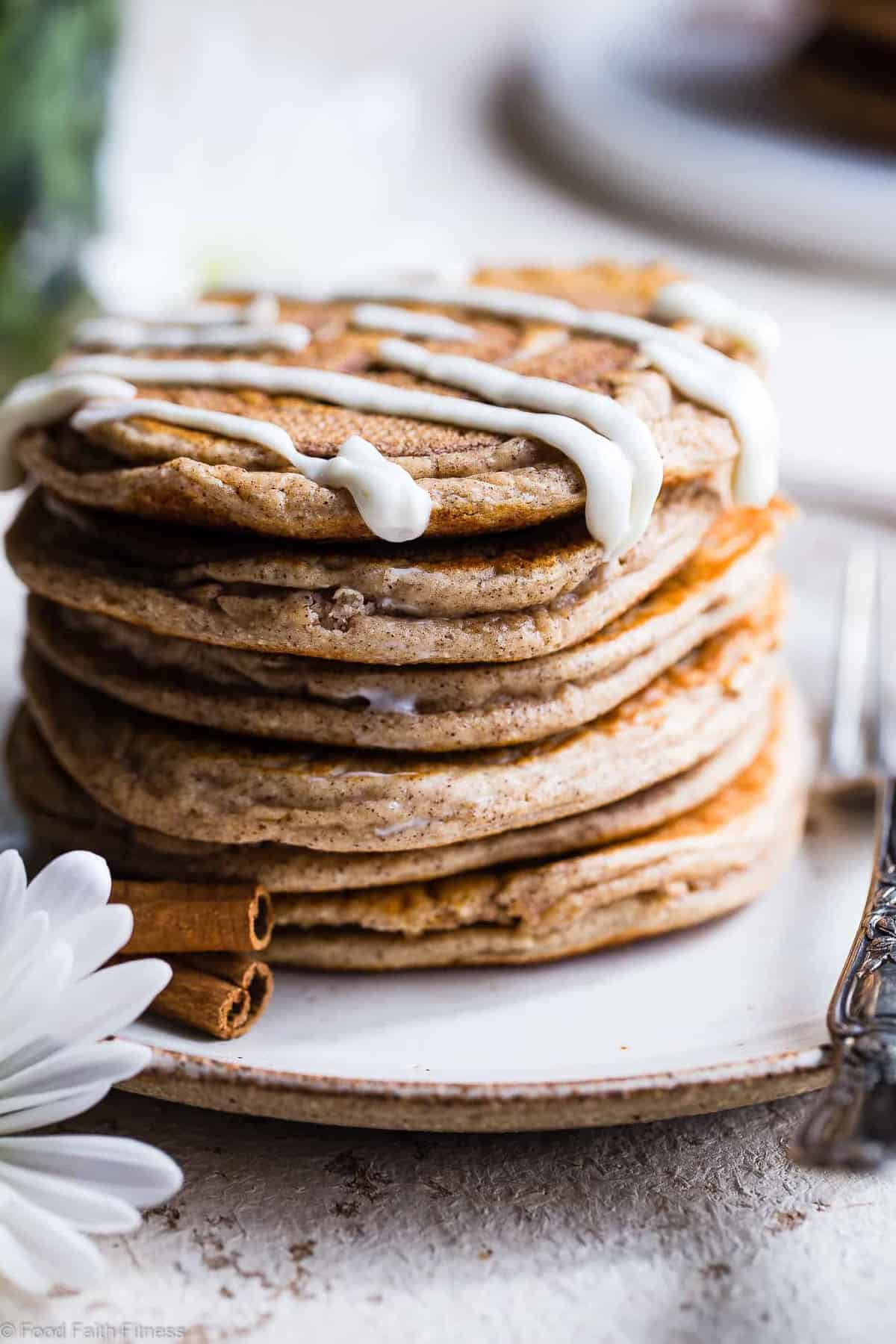 Easy Cinnamon Roll Gluten Free Low Carb Keto Protein Pancakes -These EASY, low carb high protein pancakes recipe is going to be your new favorite breakfast! Great for kids and adults and packed with 23g of protein!Who doesn't want to wake up to healthy cinnamon rolls?! | #Foodfaithfitness | #Keto #Lowcarb #Glutenfree #Healthy #Pancakes