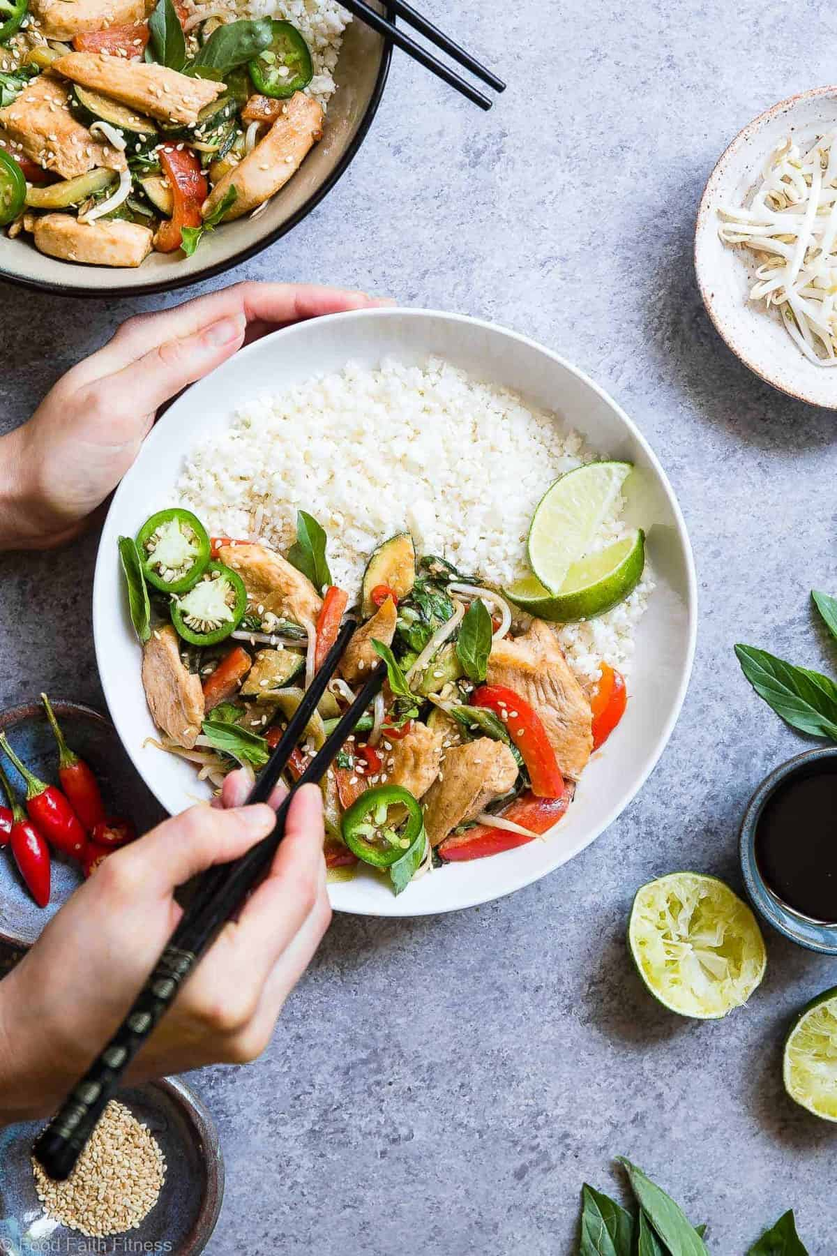 Spicy Thai Basil Chicken Stir Fry - This Thai chicken with basil stir fry is a 20 minute, healthy, gluten free dinner that is paleo friendly, lower carb and only 300 calories! It will be your new go to weeknight meal! | #Foodfaithfitness | #Glutenfree #Paleo #Lowcarb #Healthy #DairyFree