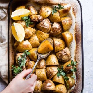 Oven Roasted Lemon Greek Potatoes -These are the BEST Oven Roasted Lemon Greek Potatoes! Tangy, zesty and so packed with flavor you will make them all the time! SO easy, whole30 complaint and vegan/ gluten free too! | #Foodfaithfitness | #Glutenfree #Vegan #Whole30 #Healthy #Dairyfree
