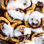 Gluten Free Vegan Pumpkin Cinnamon Rolls - These easy Pumpkin Spice Cinnamon Rolls are so soft and fluffy you won't believe they're gluten, dairy and egg free! Loaded with spicy-sweet fall flavor and SO delicious! | #Foodfaithfitness | #Glutenfree #vegan #dairyfree #eggfree #pumpkin