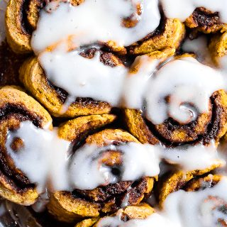 Gluten Free Vegan Pumpkin Cinnamon Rolls -These easy Pumpkin Spice Cinnamon Rolls are so soft and fluffy you won't believe they're gluten, dairy and egg free! Loaded with spicy-sweet fall flavor and SO delicious!   #Foodfaithfitness   #Glutenfree #vegan #dairyfree #eggfree #pumpkin