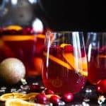 Sparkling Holiday Champagne Sangria - Full of tart cranberries and sweet oranges, this is an easy, better-for-you cocktail that is perfect to serve a crowd this Holiday season! Fizzy, festive and tasty! | #Foodfaithfitness | #Glutenfree #Sangria #Dairyfree #Vegan #Champagne