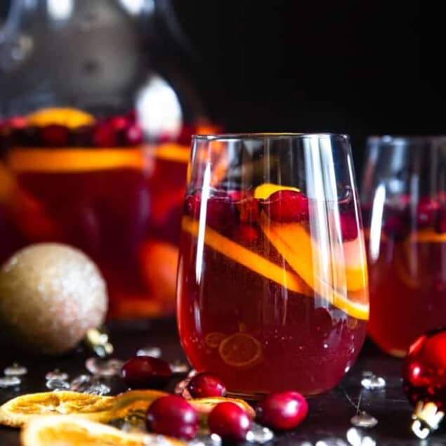 Sparkling Holiday Champagne Sangria - Full of tart cranberries and sweet oranges, this is aneasy, better-for-you cocktail that is perfect to serve a crowd this Holiday season! Fizzy, festive and tasty! | #Foodfaithfitness | #Glutenfree #Sangria #Dairyfree #Vegan #Champagne