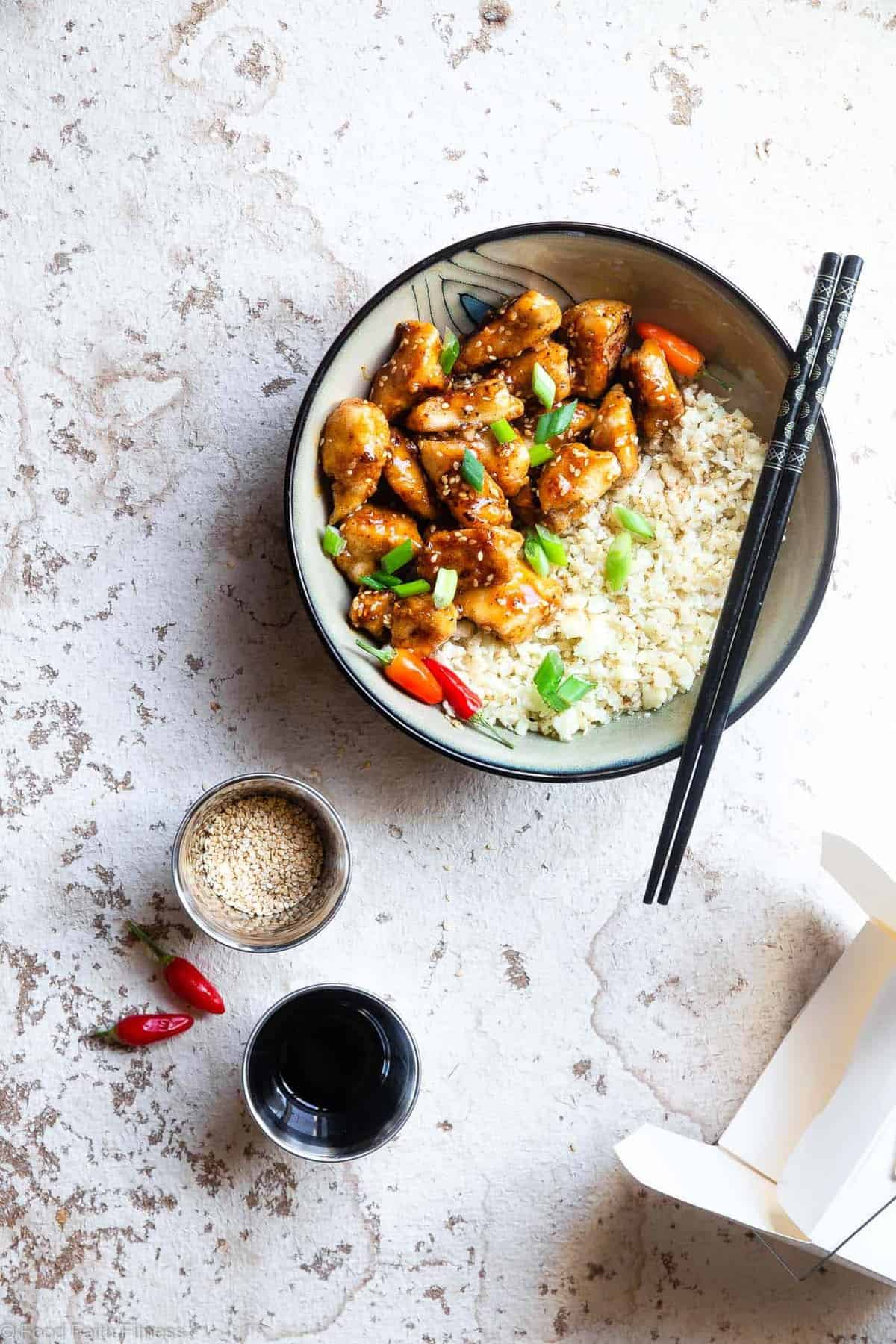 Paleo Easy Gluten Free Healthy Sesame Chicken Recipe - This paleo friendly, and sugar/grain/dairy and gluten free CRISPY easy Sesame Chicken tastes just like takeout but is SO much better for you! A quick dinner that the whole family will love! | #Foodfaithfitness | #Glutenfree #Paleo #Whole30 #Sugarfree #Healthy