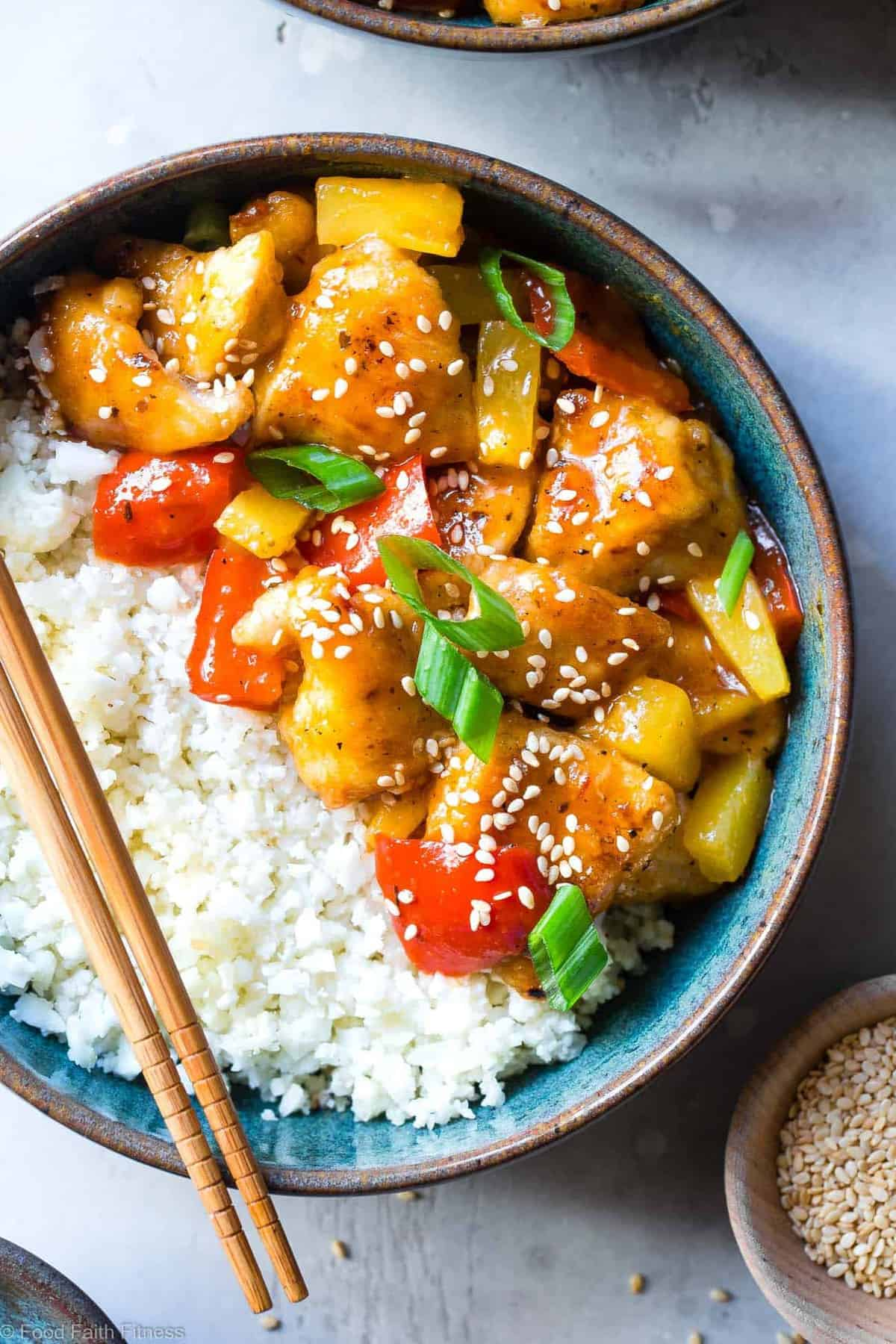 Gluten Free Whole30 Sweet and Sour Chicken - This paleo friendly, healthy sweet and sour chicken is so easy to make and tastes better than takeout and is WAY better for you! It's sugar/grain/gluten/dairy/egg free too! | #Foodfaithfitness | #Glutenfree #Paleo #Whole30 #Healthy #Sugarfree