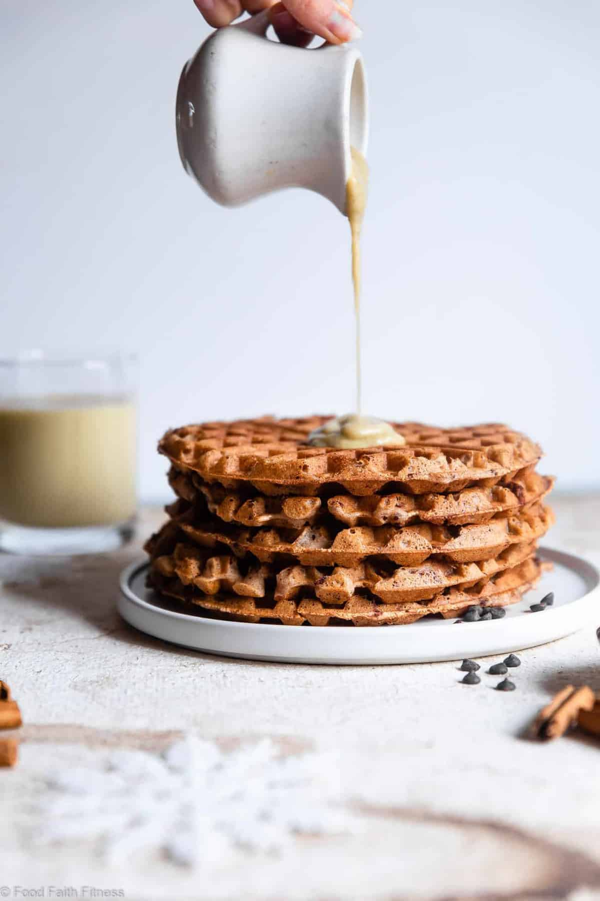 """Gluten Free Vegan Waffles with Eggnog """"Cream"""" Sauce -These FLUFFY vegan waffles are studded with chocolate chips and covered with a healthy eggnog """"cream"""" sauce! A delicious holiday breakfast that you can make ahead for easy mornings! 