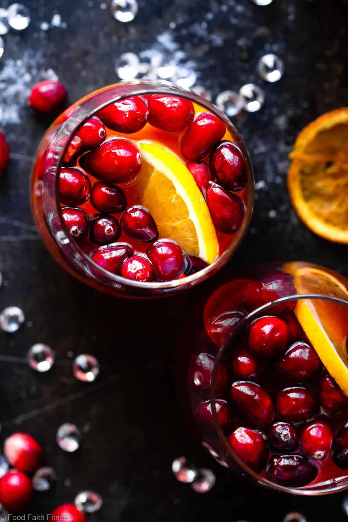 Sparkling Red Sangria - Full of tart cranberries and sweet oranges, this champagne sangria recipe is an easy, better-for-you cocktail that is perfect to serve a crowd this Holiday season! Fizzy, festive and tasty! | #Foodfaithfitness |