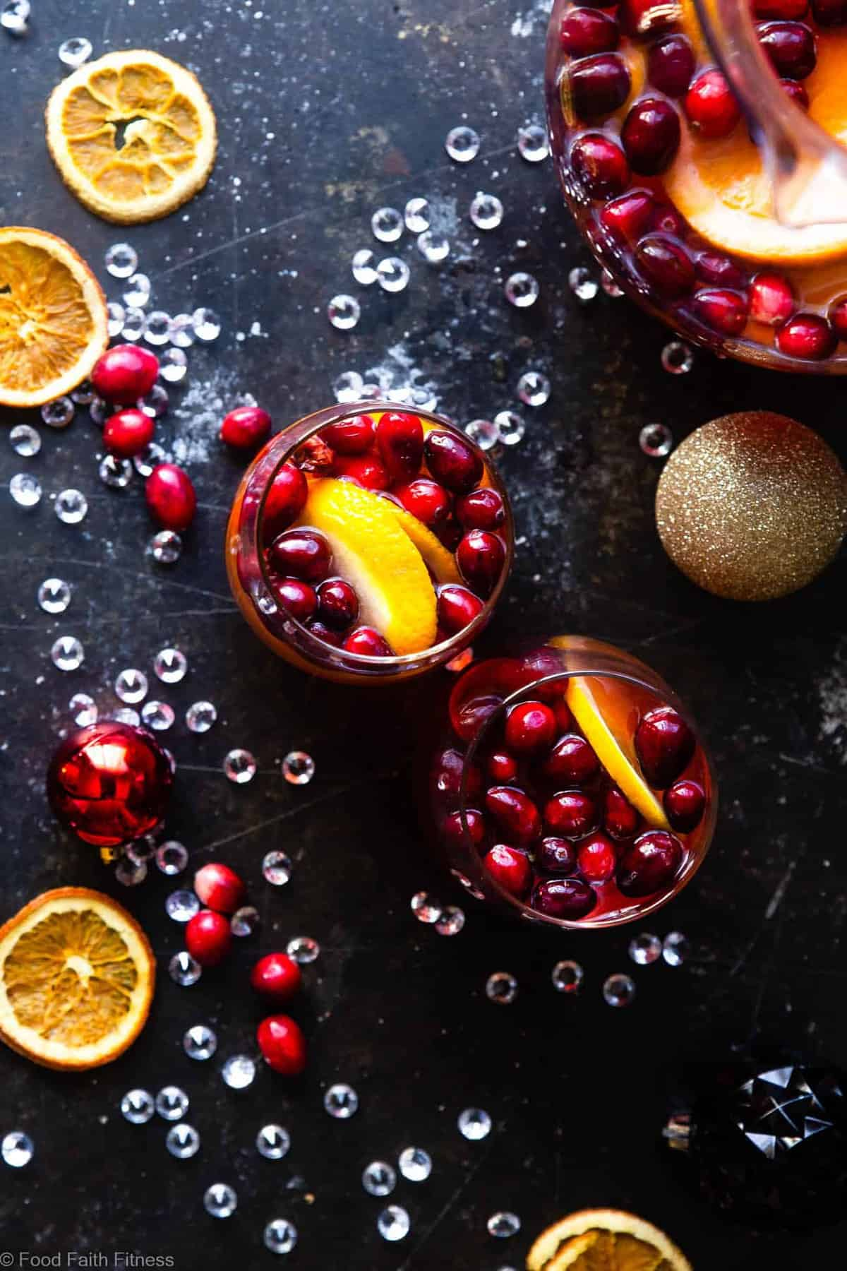 Sparkling Holiday Champagne Sangria - Full of tart cranberries and sweet oranges, this is an easy, better-for-you cocktail that is perfect to serve a crowd this Holiday season! Fizzy, festive and tasty! | #Foodfaithfitness |