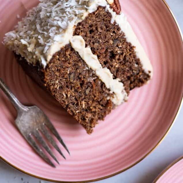 "Paleo Carrot Cake - This dairy, grain and gluten free, Paleo Carrot Cake with Almond Flour has a luscious cashew ""cream cheese"" frosting and is easy to make! Always a hit with a crowd! 