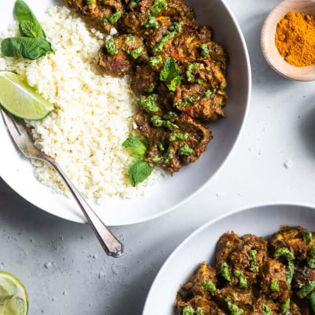 Indian Spiced Chicken with Cashew Cilantro Pesto - This chicken curry with a creamy pesto made of cashews is an easy, weeknight dinner with big bold flavor! Gluten free, paleo, whole30 and low carb too!   #Foodfaithfitness   #glutenfree #paleo #lowcarb #keto #whole30