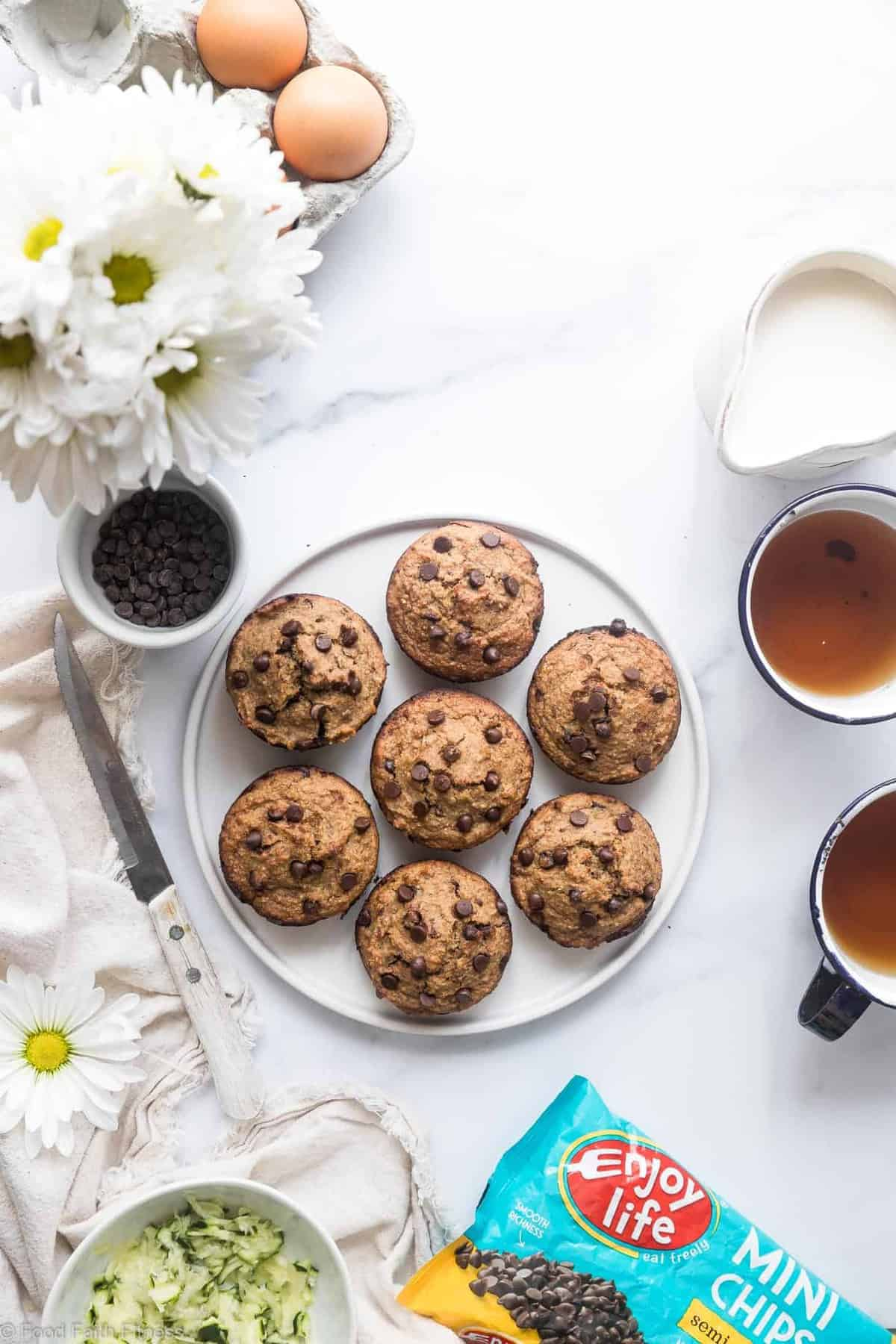 Healthy Gluten Free Zucchini Muffins - These dairy free Zucchini Muffins are fluffy and gluten, dairy, oil and sugar free! Sweetened with dates, studded with chocolate chips and only 170 calories! Great for kids and adults!   #Foodfaithfitness   #Glutenfree #Dairyfree #Healthy #Zucchini #sugarfree