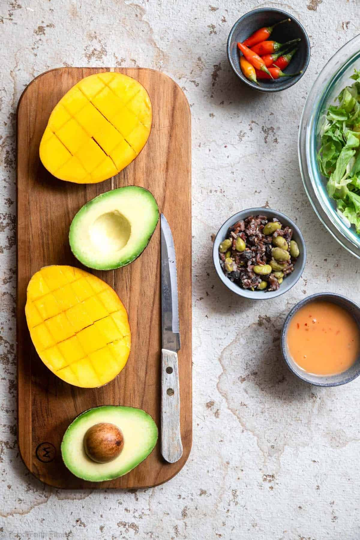 Mangoes and avocado on a cutting board to make Thai beef salad recipe