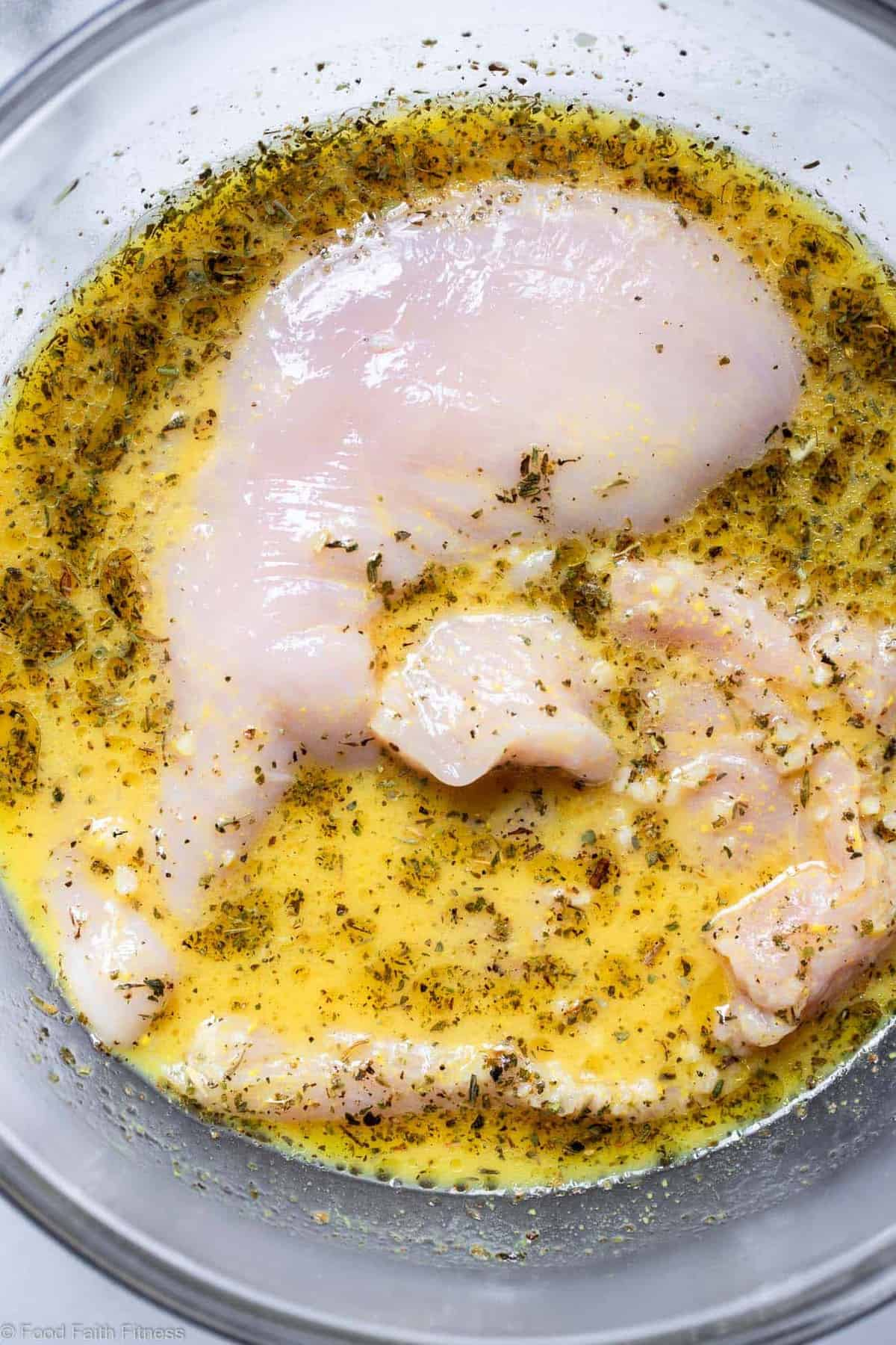 Grilled Chicken breast in a bowl of marinade