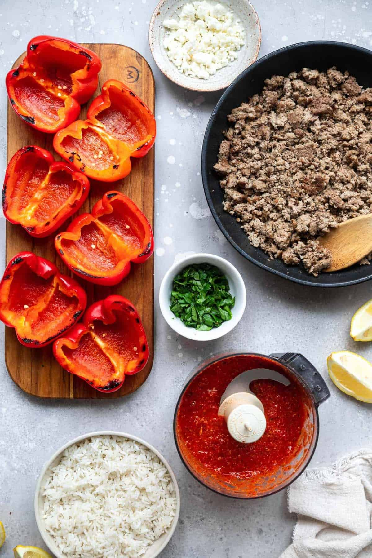 ingredients to make grilled stuffed bell peppers on a table