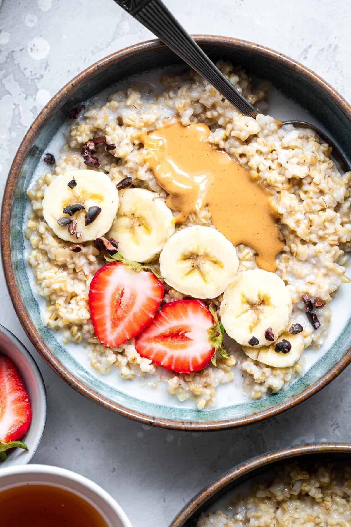 cooked instant pot steel cut oats in a bowl with strawberries and bananas