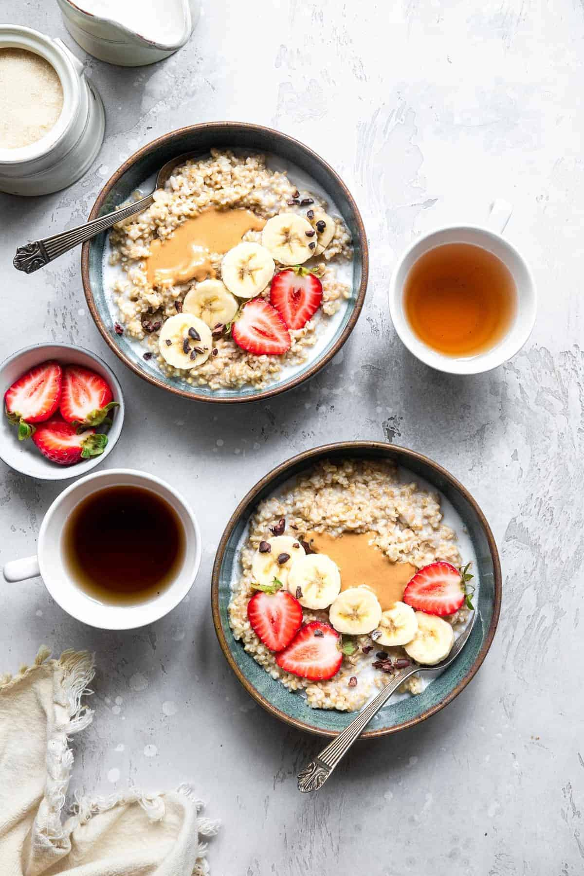 Instant Pot steel cut oatmeal in 2 bowls with strawberries