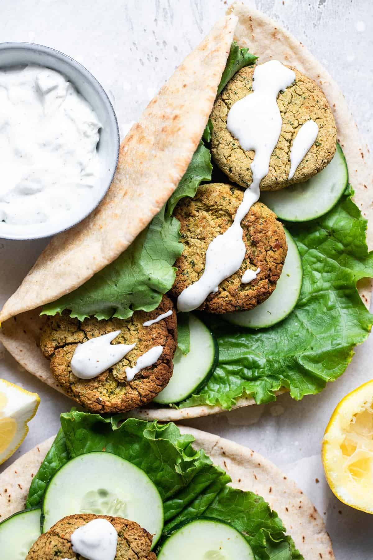baked falafel in a pita bread with yogurt sauce