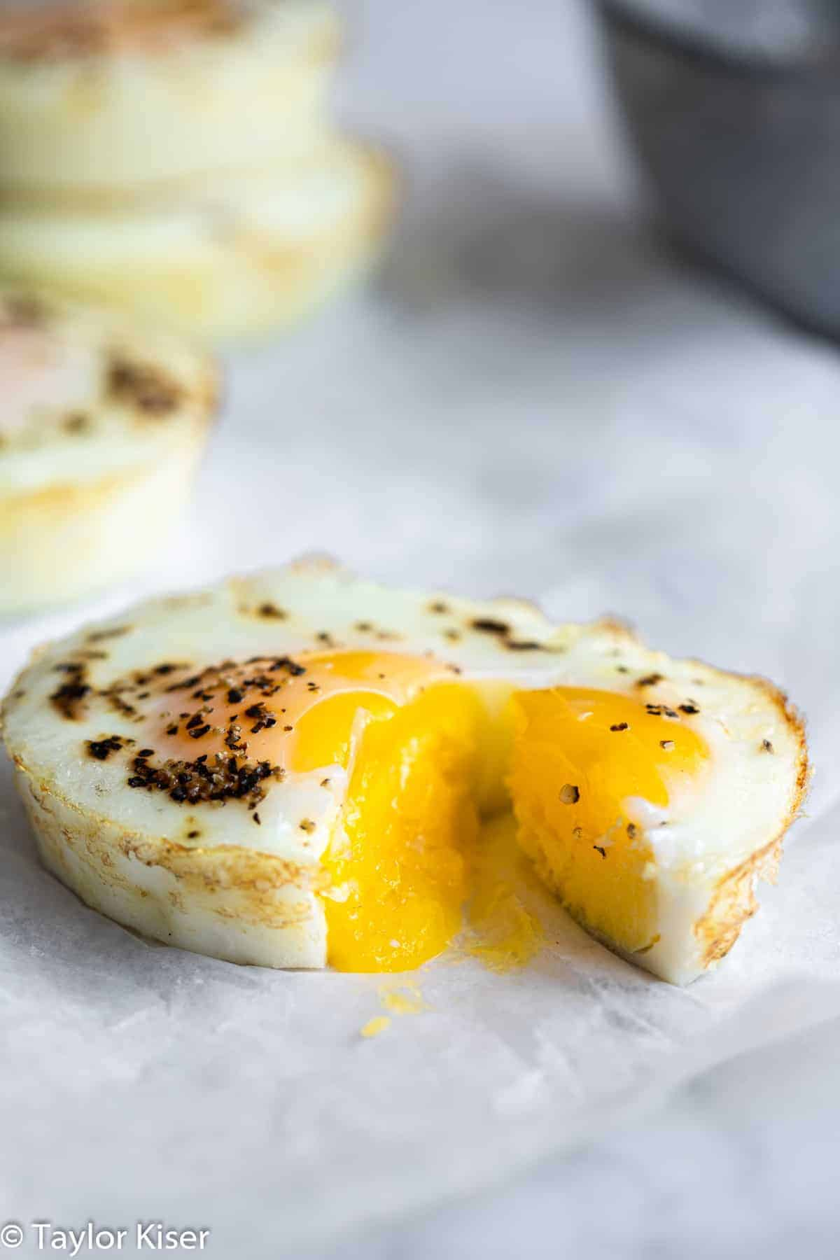 oven baked eggs cut open with a runny yolk