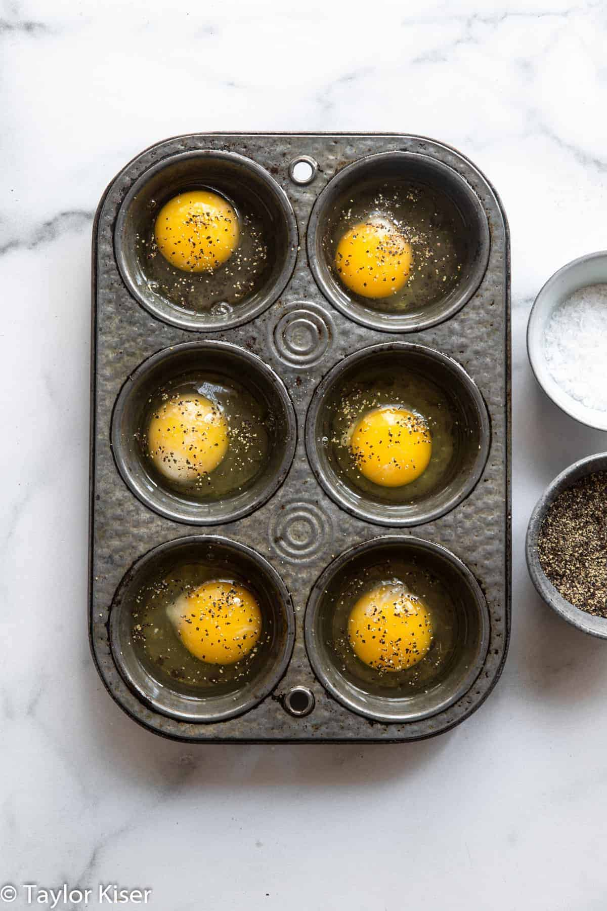 raw eggs in a muffin tin for how to cook eggs in the oven