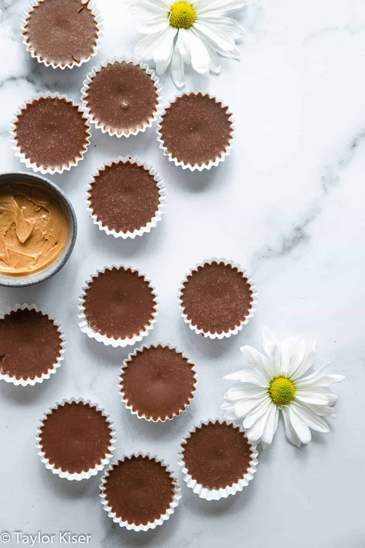 chocolate keto fat bombs on a table with flowers