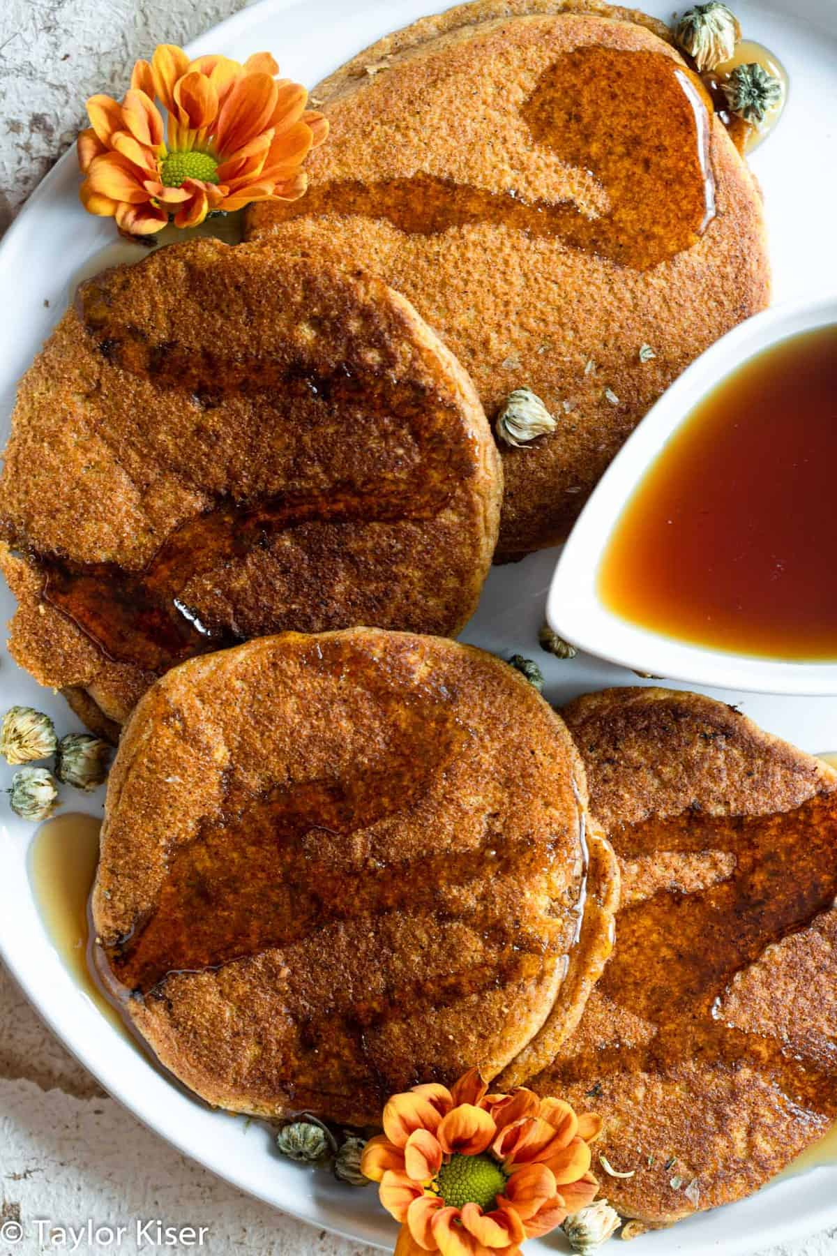 easy pumpkin pancakes layed out on a plate