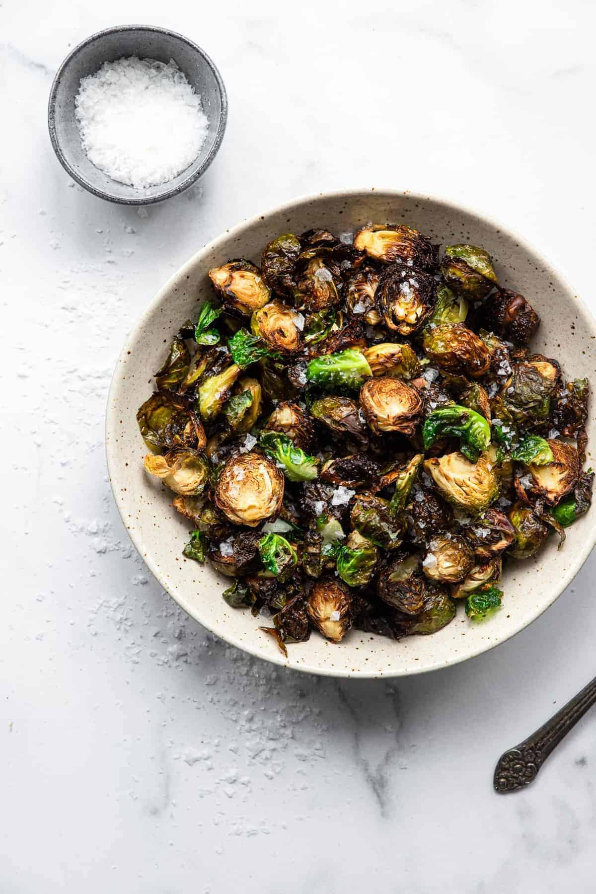 air fryer brussel sprouts in a bowl on a table