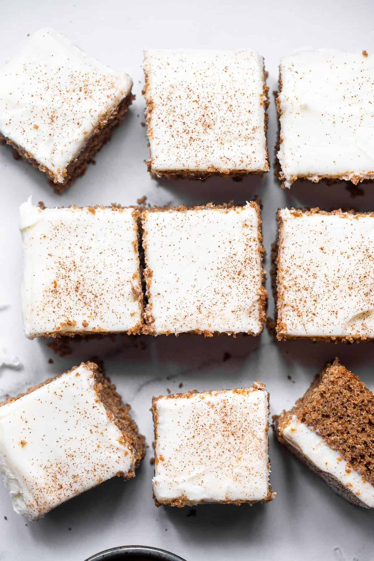 Gluten free gingerbread sliced into squares on a table