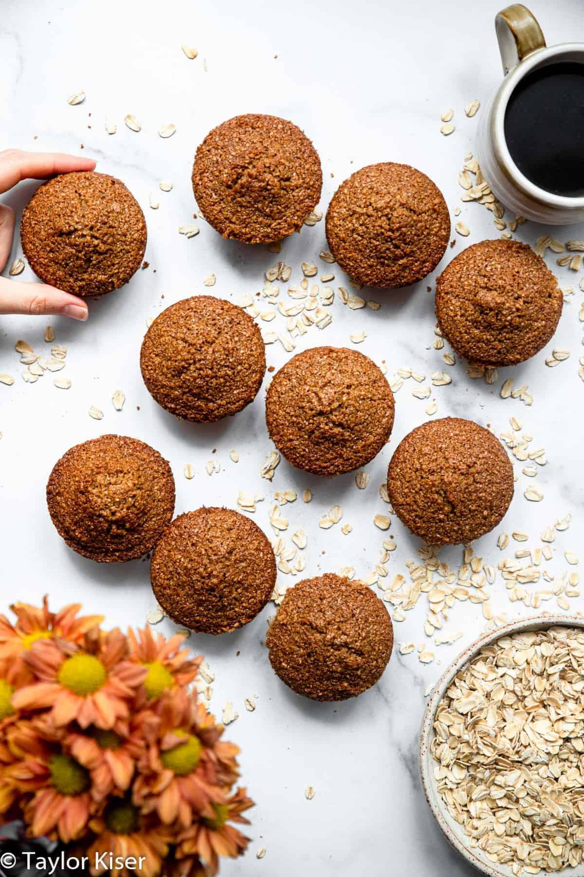 overhead of gluten free oat bran muffins on a table