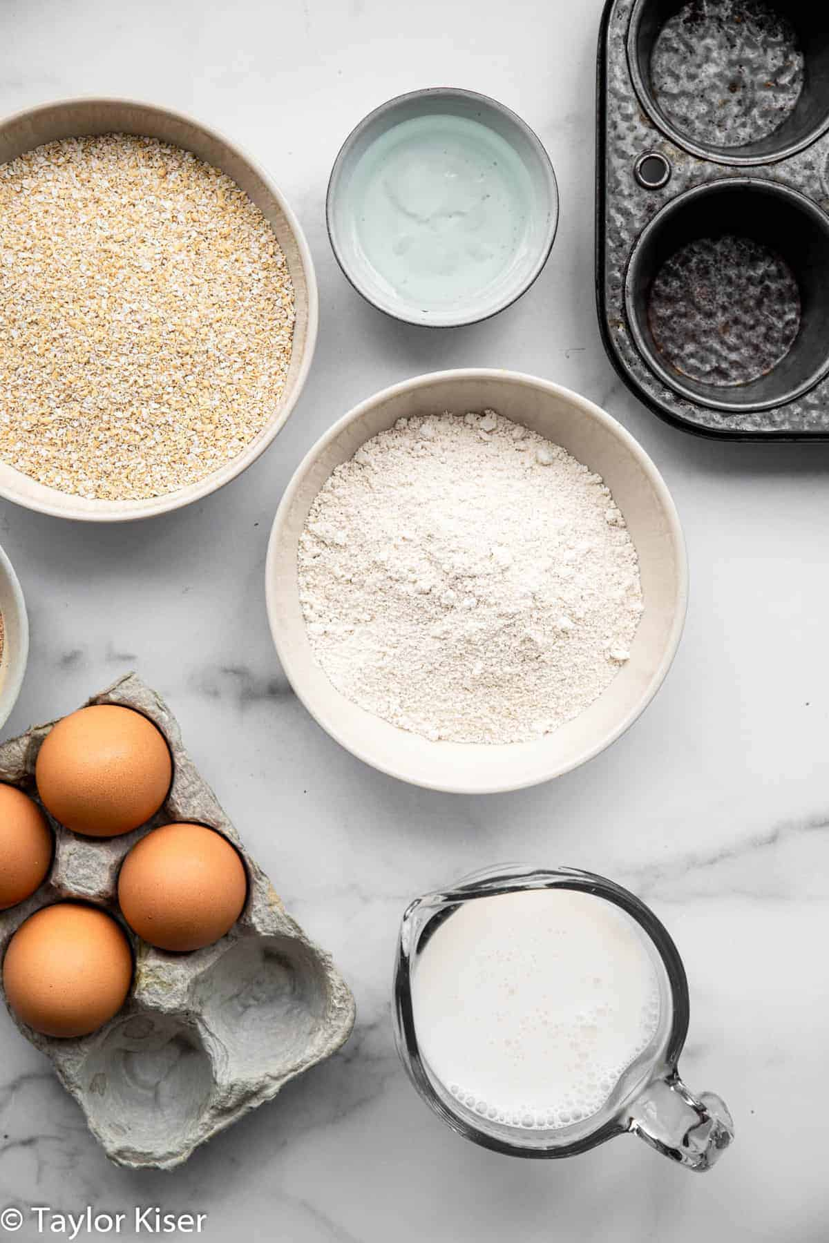 ingredients for an oat bran muffin recipe in bowls