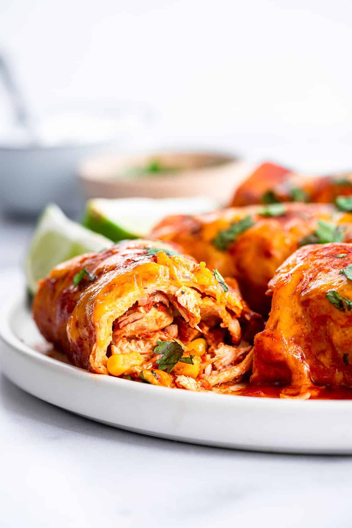 crock pot chicken enchiladas cut open on a plate