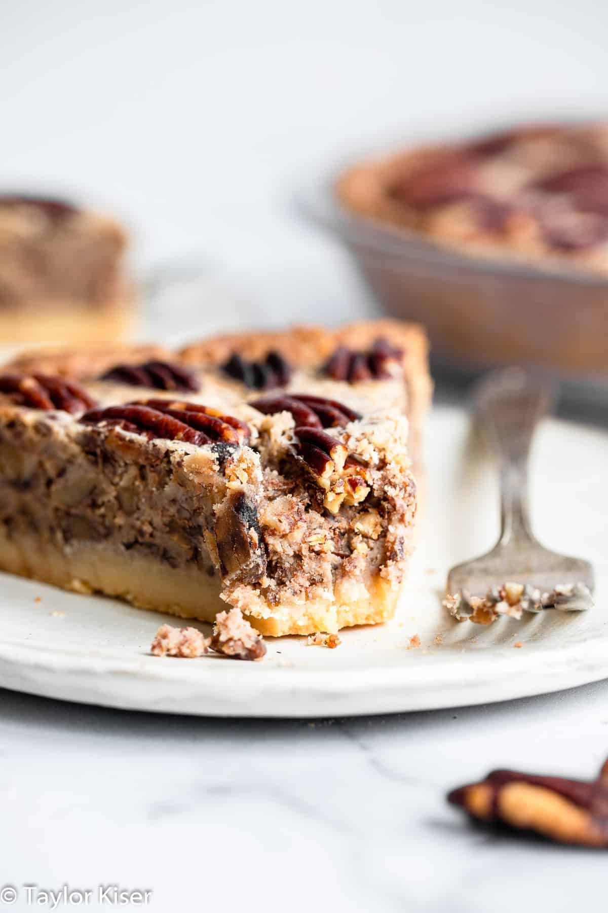 sugar free low carb keto pecan pie on a plate with a bite taken out