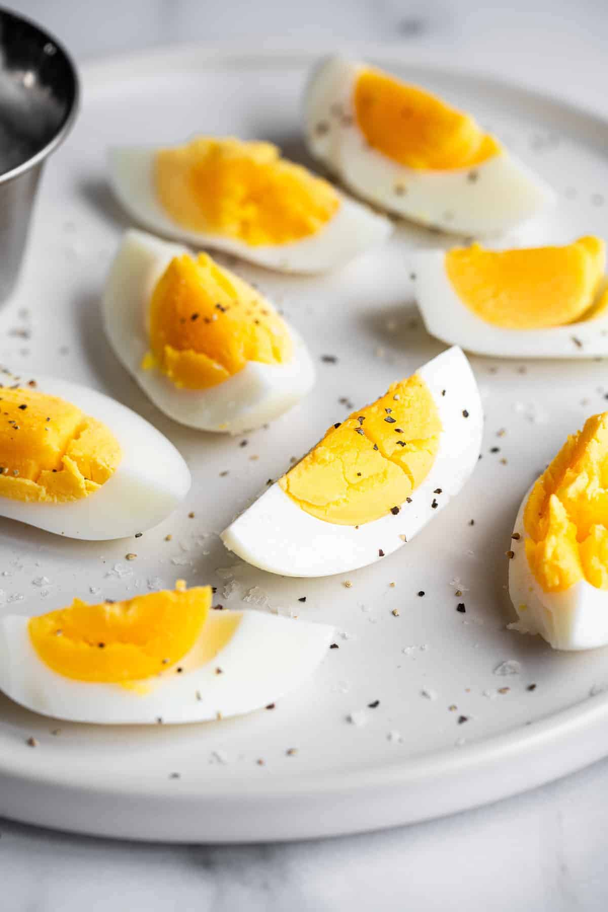 sliced air fryer hard boiled eggs with pepper on them