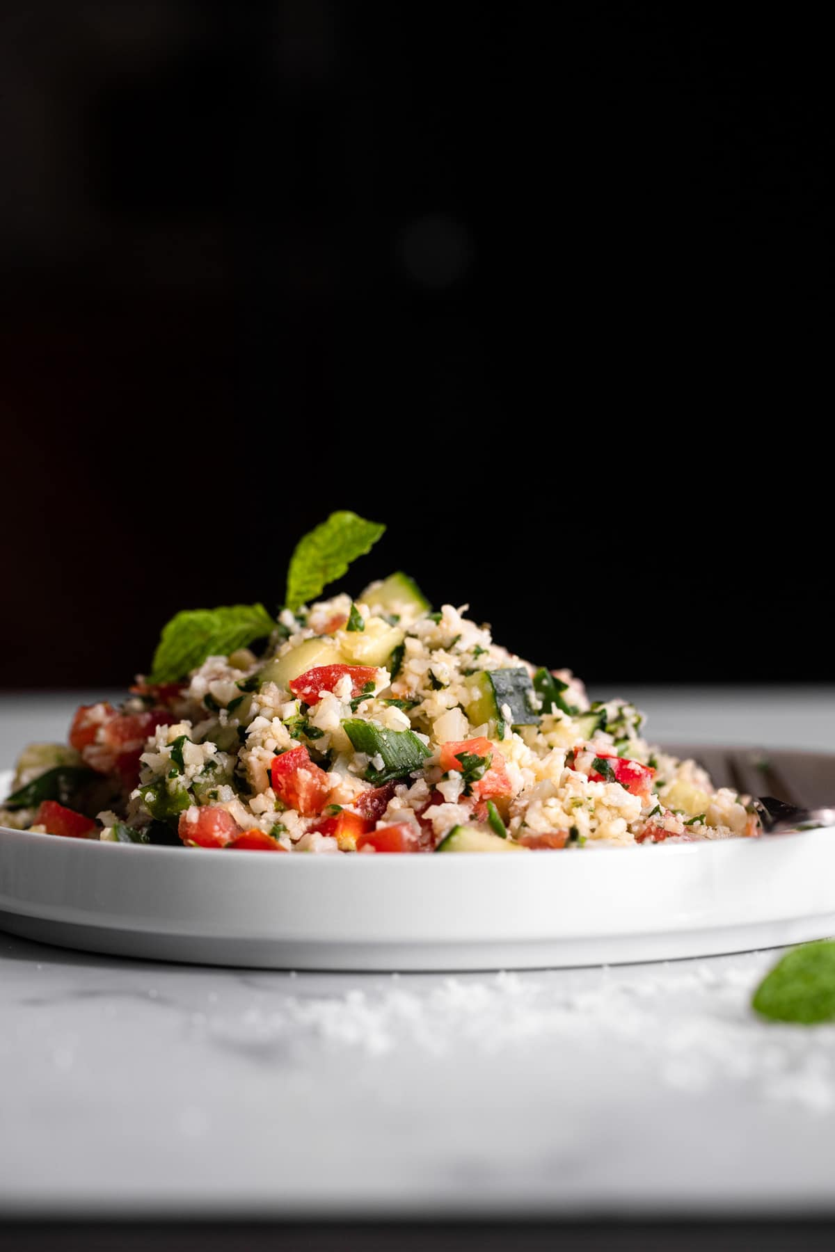 side photo of Cauliflower Tabbouleh on a serving plate