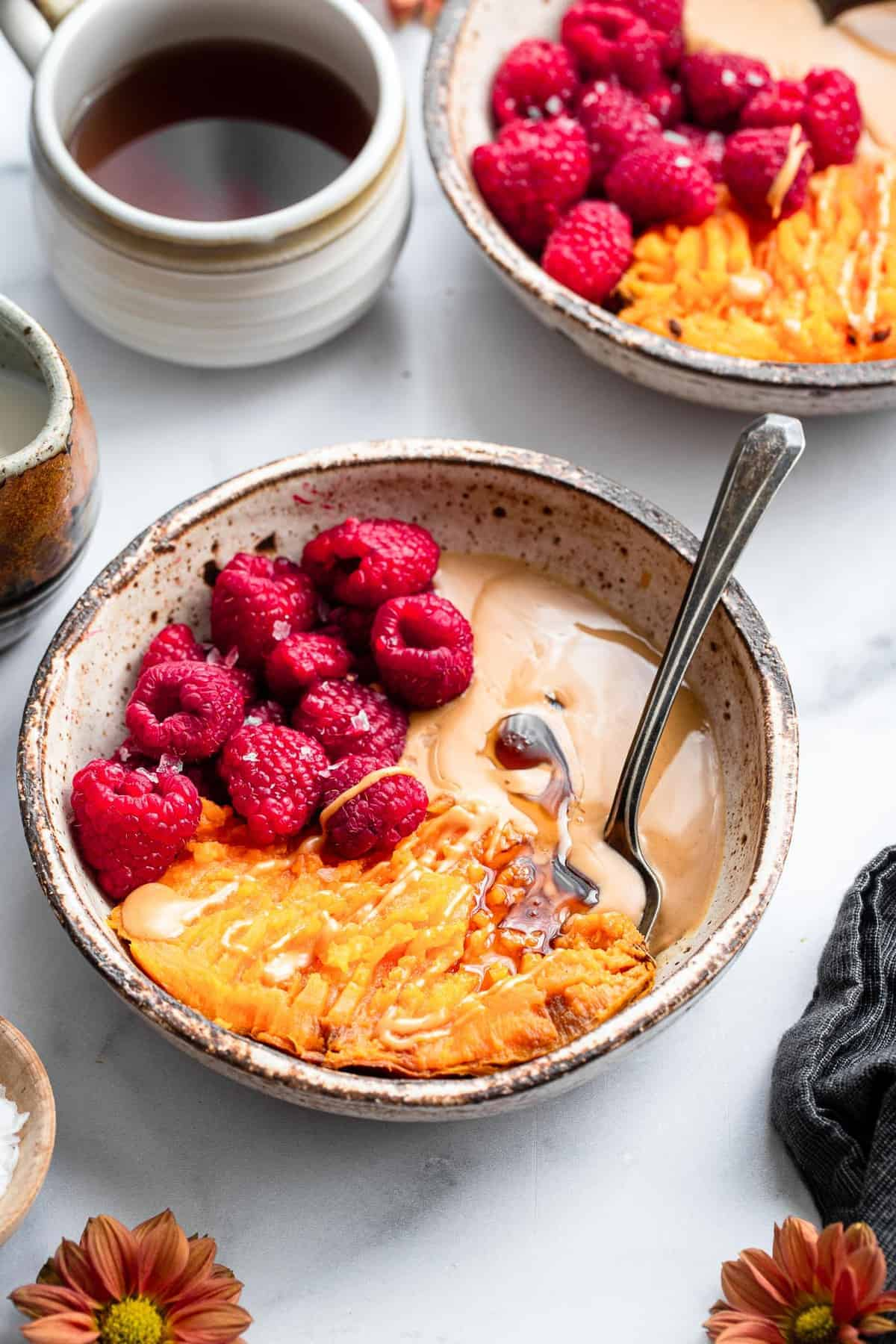 sweet potato breakfast bowl on a table with coffee on the side