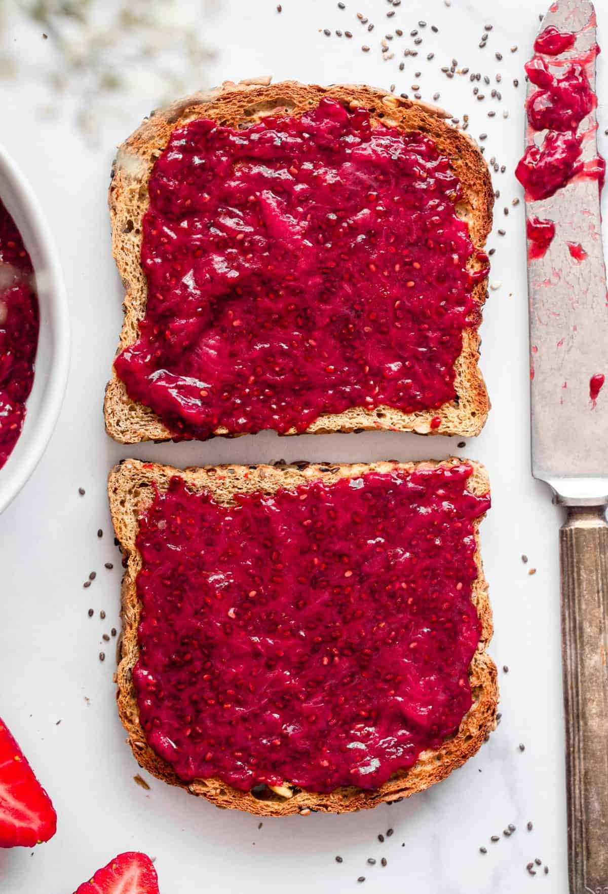 strawberry chia jam spread on 2 slices of toast