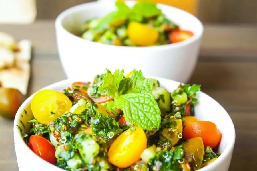 quinoa Tabbouleh salad in a bowl with mint leaves