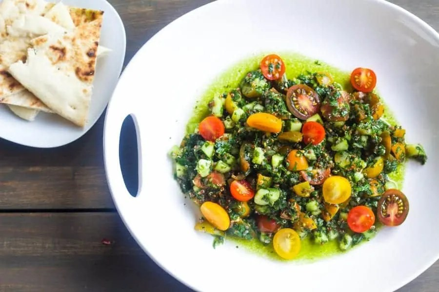 quinoa Tabbouleh salad in a bowl with pita bread