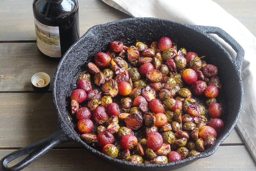 roasted purple brussel sprouts and grapes in a skillet #grapes #brusselsprouts www.foodfidelity.com