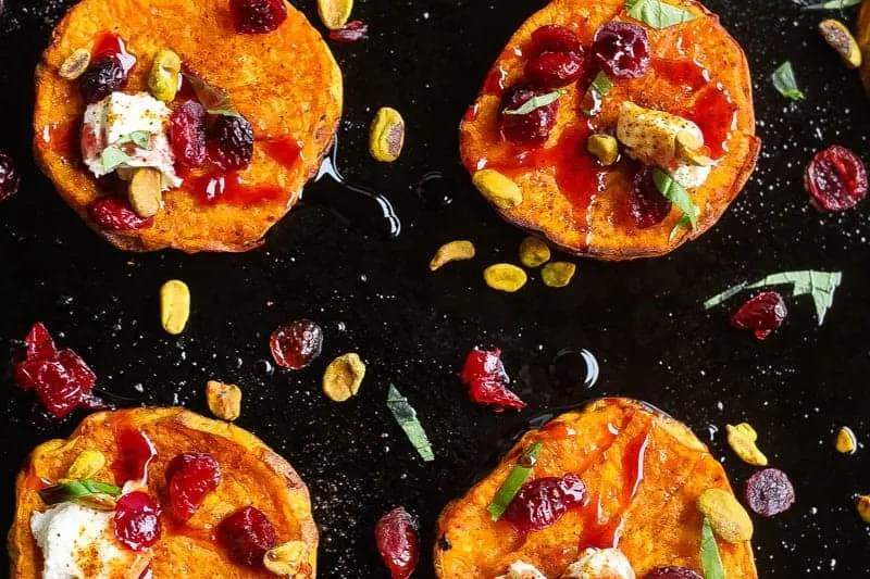 roasted sweet potato salad rounds topped with goat cheese,pistachios, and wine soaked cranberries