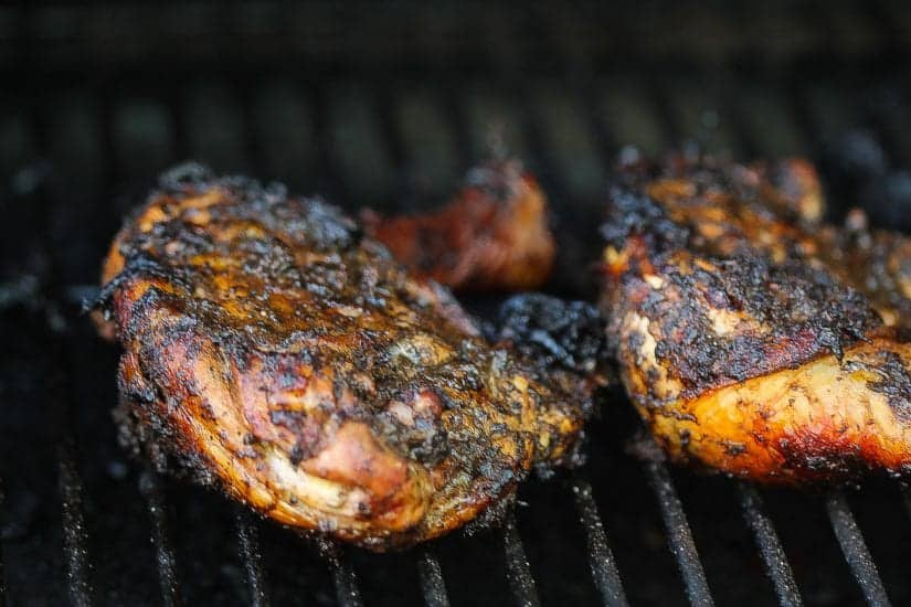 caribbean jerk chicken leg quarters on the grill