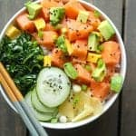 salmon poke bowl with cucumbrs, collard green salad, avocado, pickled beets and ginger