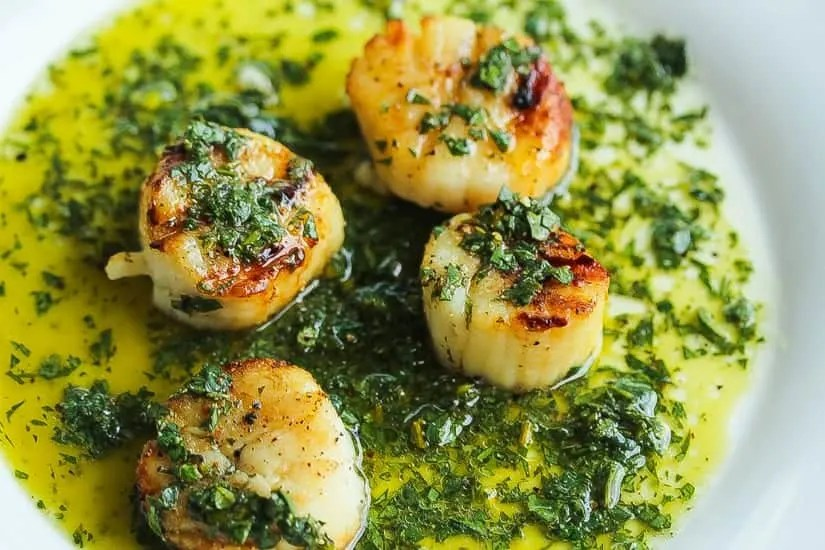 grilled scallops topped with salsa verde