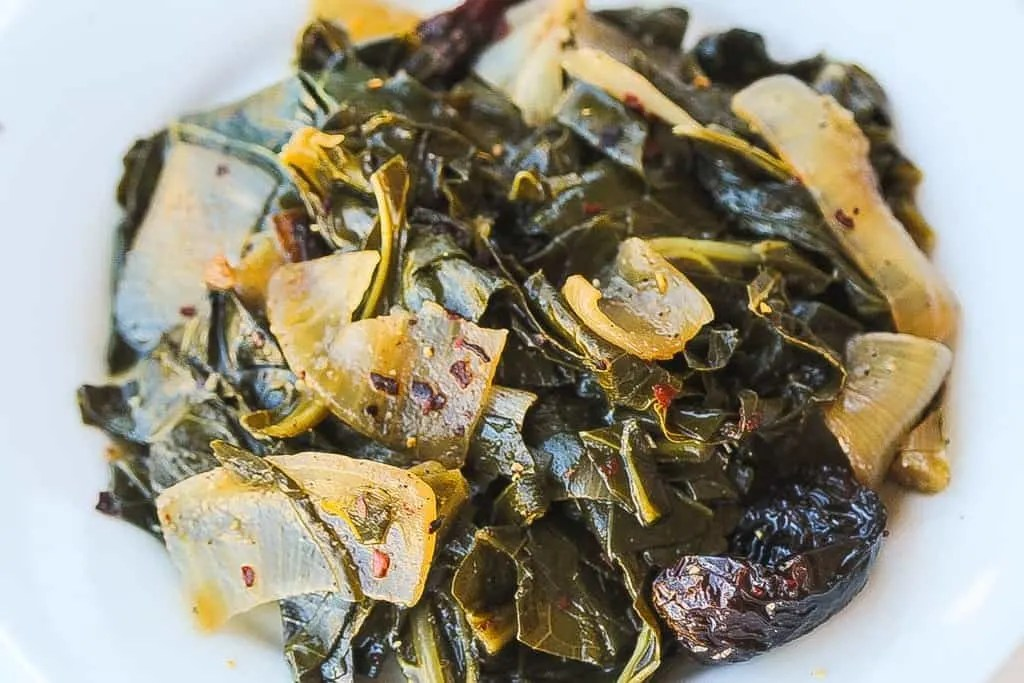 meatless wine braised collard greens with onions in a bowl