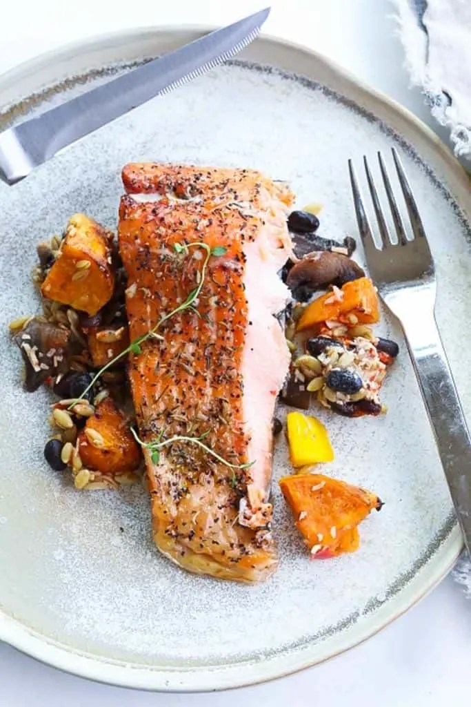 smoked trout on a plate with vegetables