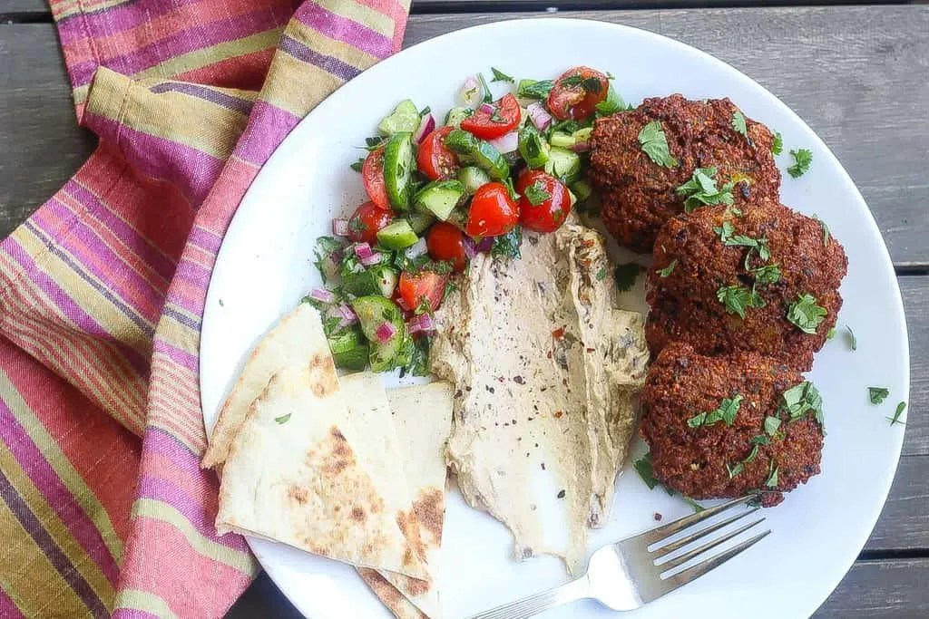 blackeyed pea falafel with hummus and persian cucumber salad
