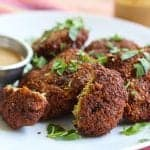 blackeyed pea falafel on a plate with tahini sauce