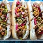 andouille sausage dog topped with mustard, pickled red onions, and chow chow