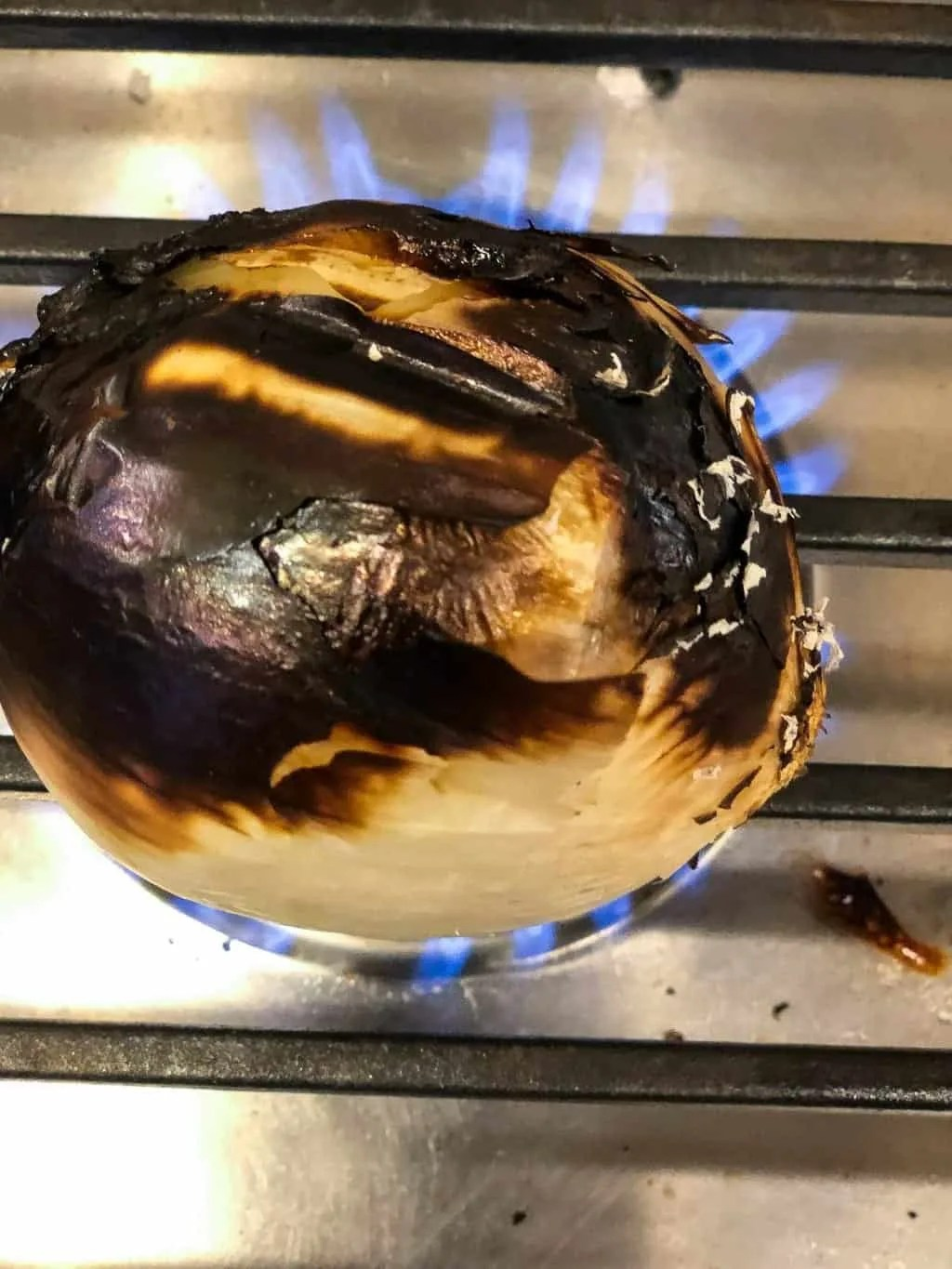 charred onion on cooktop