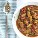stewed okra and tomatoes ina white bowl